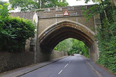 Image of a railway bridge over a road in Farncombe, where Lingard Jones provides Handyman Services