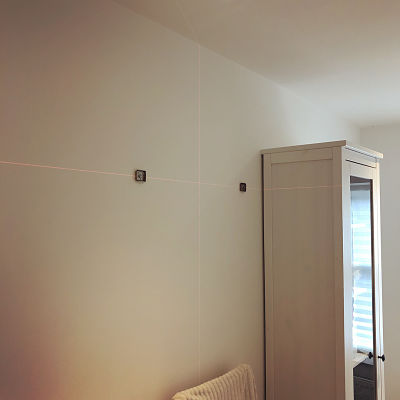 Installing towel rail with Stanley Cubix laser level