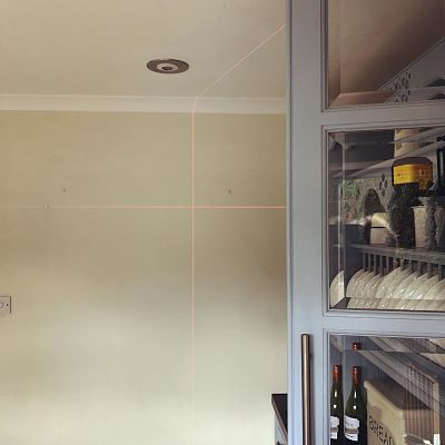 Stanley Cubix laser level projected onto kitchen wall